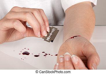 hoja de afeitar, suicidio