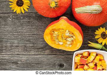 Hokkaido pumpkin on a wooden table
