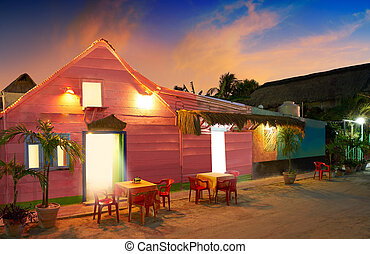 Holbox Island sunset colorful houses Mexico