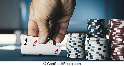Hold 'em Texas poker tournament at casino: a man is holding ...