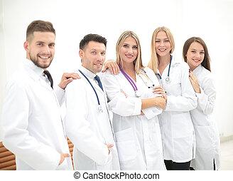 hold, i, medicinske professionals, kigge kamera hos, smil.