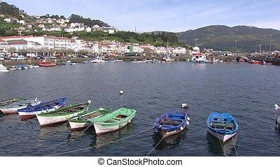 Hold + pan - small fishing boats in Muros harbor at Atlantic coast, Spain