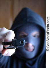 A gunman point a hand gun at you