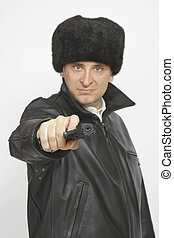 Russian man pointing his gun down the lens