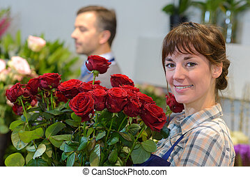holding a bunch of roses