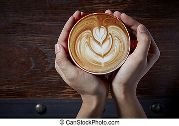 Holding a cup of coffee