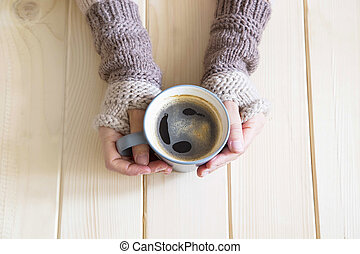 Holding a cup of coffee, top view