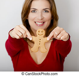 Holding a Gingerbread cookie