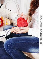 holding a heart-shaped box