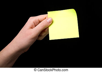 A blank sticky note stuck to a hand - remember this