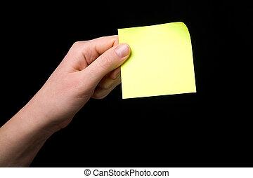 Holding a Sticky Note - A blank sticky note stuck to a hand...