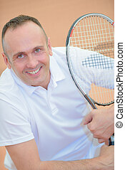 holding a tennis racket