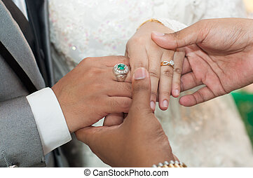 holding asian wedding lovers hands with diamond rings