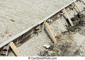 Holding Back - Wooden beams supporting cement on a...