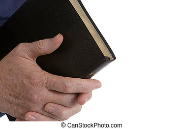 Holding Bible - Interlaced hands of a mature man hold bible....