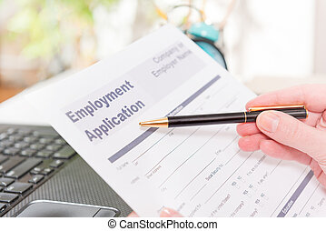 Holding blank employment application form