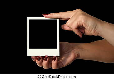 holding blank polaroid - deep black background #2