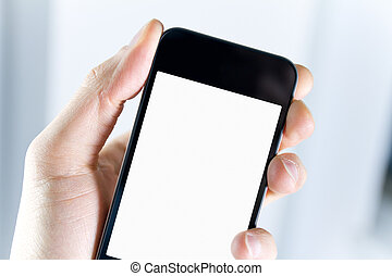 A man holding smartphone with blank screen in hand. Closeup shot.