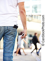 Holding cellphone with battery charger in pocket