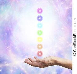 Holding chakra energy in open hand - Female healing hand...