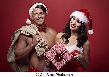 Holding Christmas present and brown sack