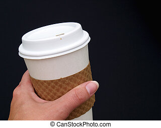 a female's hand holding a disposable paper coffee cup