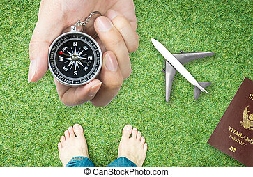Holding Compass for nature travel direction with bare feet