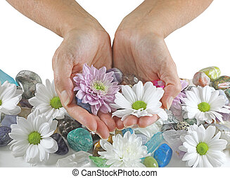 Holding daisies and Healing Crystals