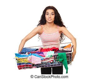 holding donna, cesto, di, vestiti