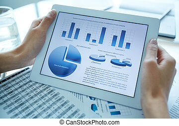 Close-up of businesswoman hands holding touchpad with electronic document