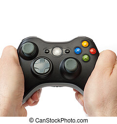Holding gaming controller - Hands holding a wireless gaming...