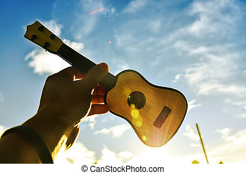 Holding guitar in the sky