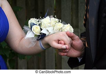 Holding Hand With Wrist Corsage - Closeup of teen prom...