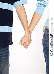 Holding Hands - A man and woman in casual clothing holding...