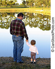 holding hands - Father and daughter looking at beautiful...