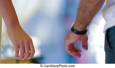 Holding hands - Man and woman holding hands. Close-up