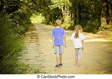 Holding hands on a dirt road