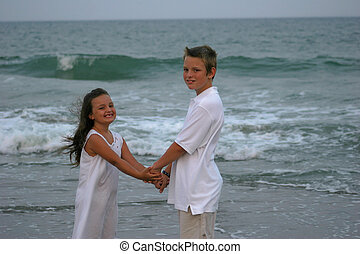holding hands on beach