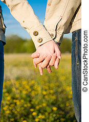 Holding hands on the field