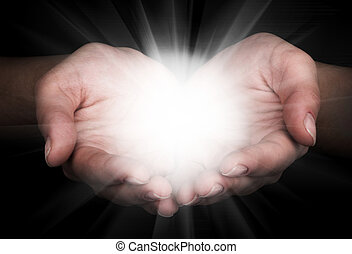 Holding hands open with glowing lights