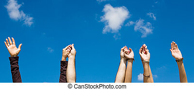 Holding Hands & Sky Banner - Hands raised and holding...
