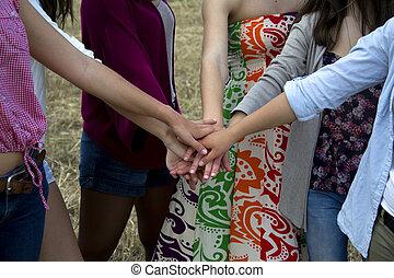 Holding hands together.