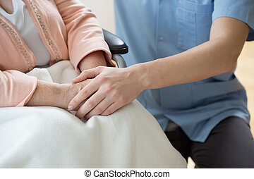 Holding hands with a nurse