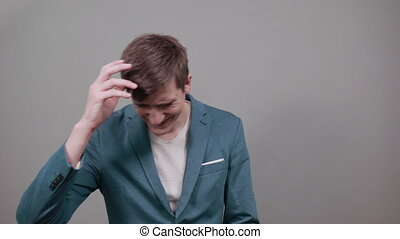 Holding head with hand can not believe shocked and despair being in panic, having forgetful look. Frustrated nervous freaking out, worrying because messed up. Young attractive man, dressed jacket