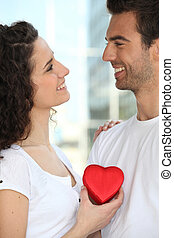 Holding heart-shaped box