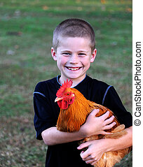 Holding His Pet Chicken