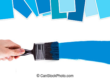 Holding Paint Brush