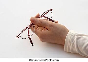 holding pair of glasses