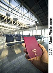 holding passport in airport