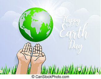 holding planet Earth in hands against green grass spring background